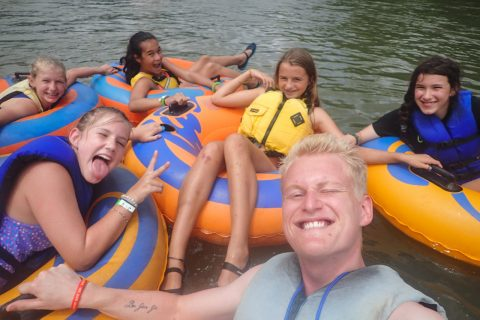 campers tubing on river