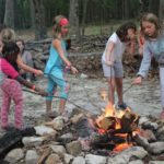 campers cooking marchmallows