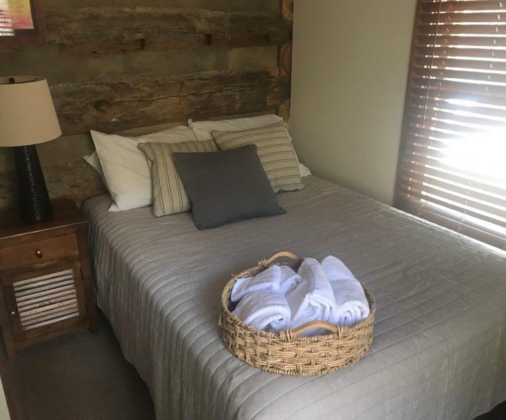 bed in log cabin